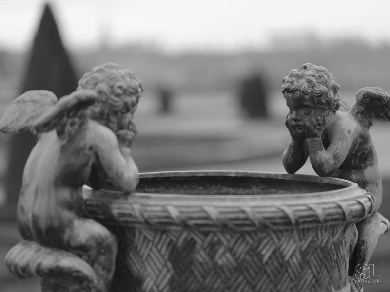 two cherubs on the side of a vase. fine art print, limited edition of 5.