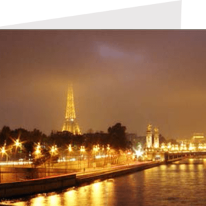 france, night photograph of the banks of the seine with the eiffel tower in the distance
