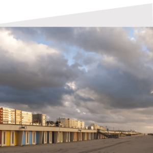 colorful beach hunts with the seafront buildings in the background